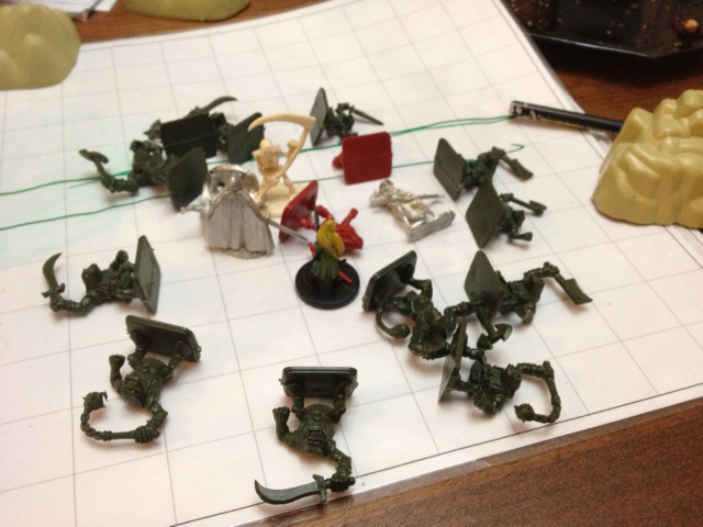 The final showdown: Ash versus the mini-orc thing leader (aka Skeleton with scythe)